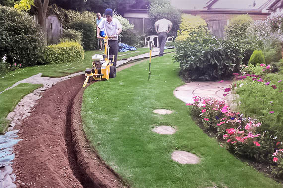 irrigation-installation-trench-by-www.homeimprovementingreenvill